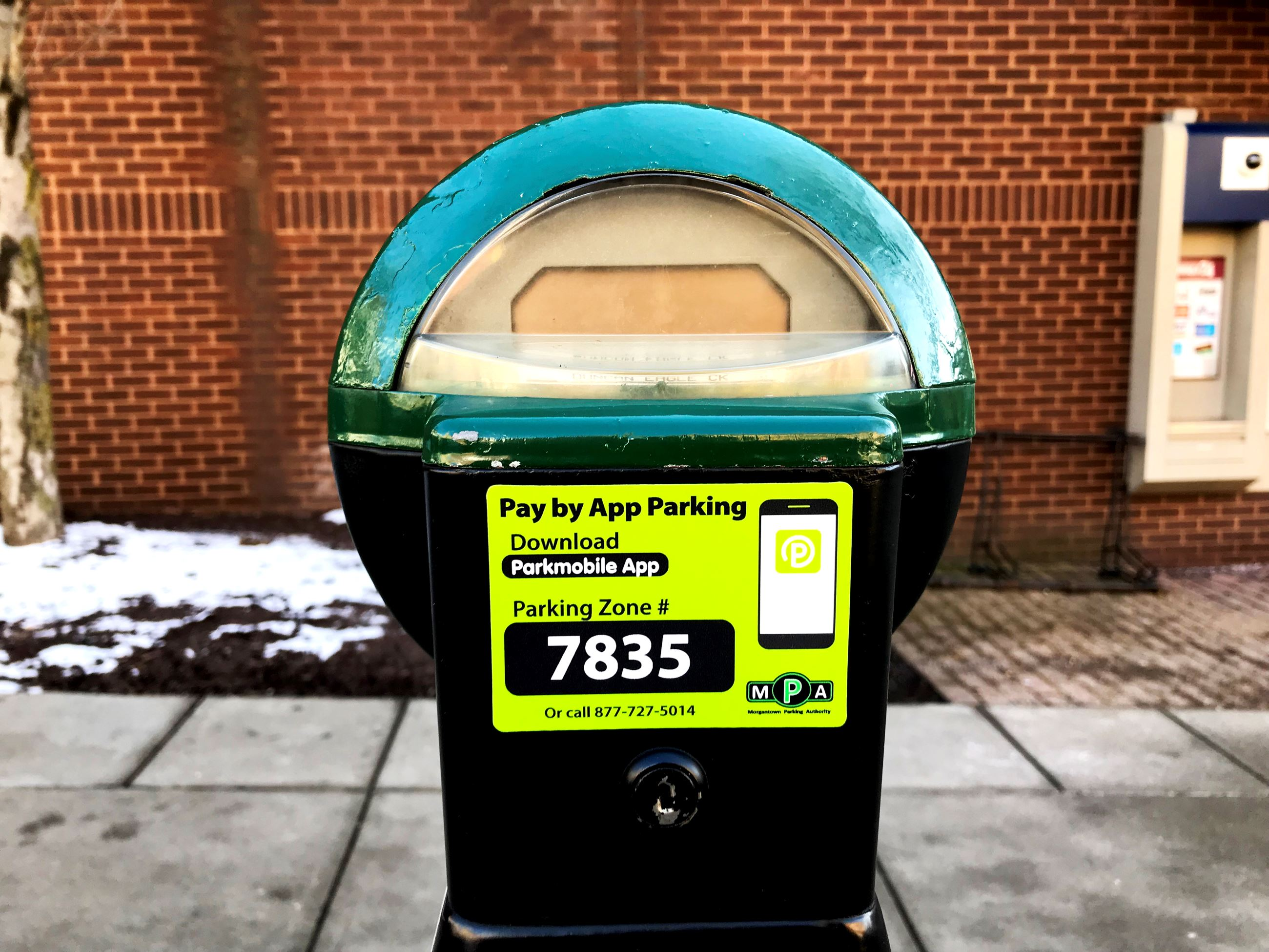 The parking meter features a new sticker from Morgantown Parking Authority partner, Parkmobile. The