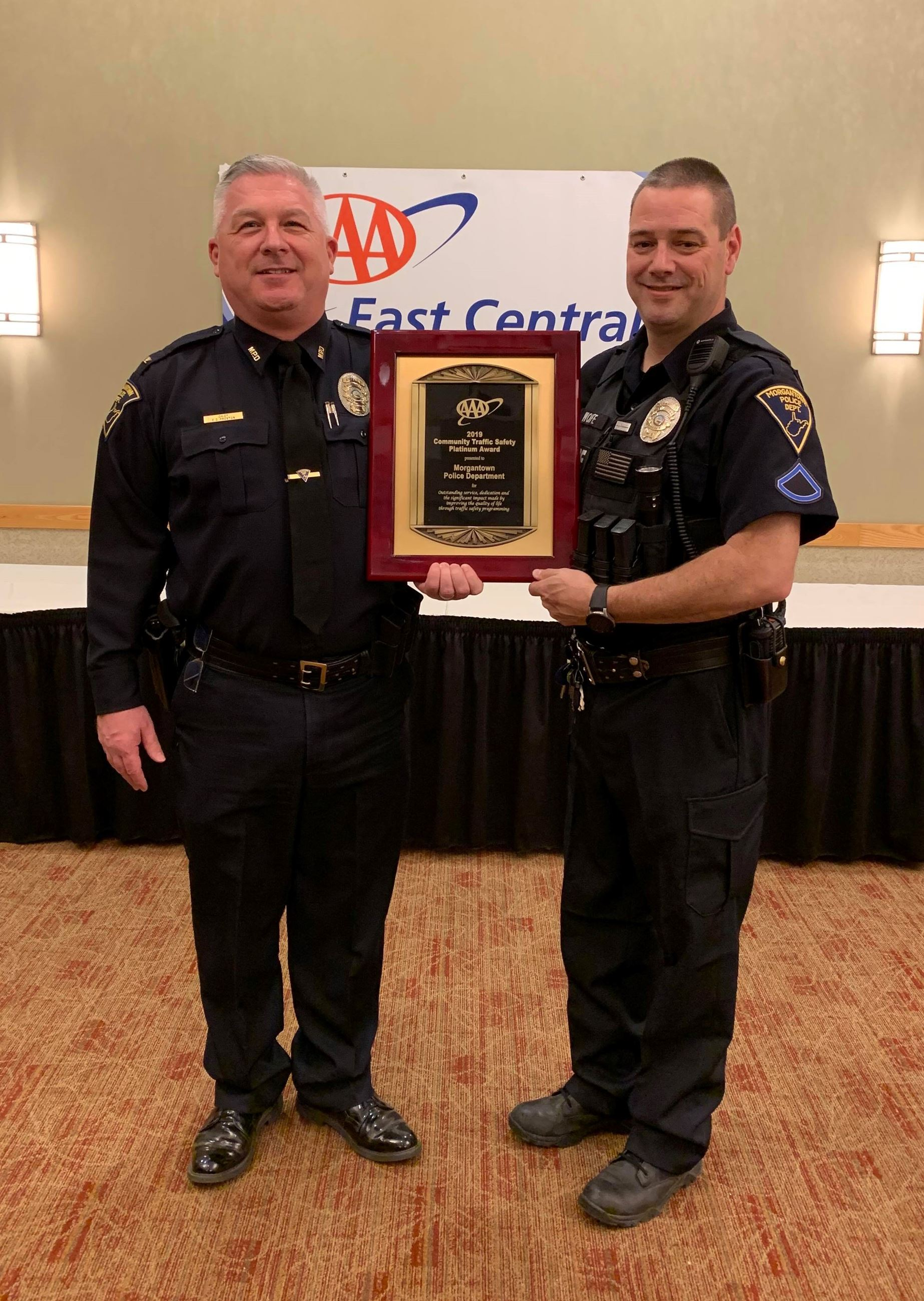 A photo of Chief Preston and Officer Wolfe holding the AAA Traffic Safety Award