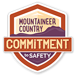 A logo for the Visit Mountaineer Country CVB Commitment to Safety.